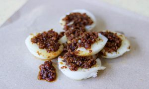 """Jian Bo Chwee Kueh from Tiong Bahru Market. Topped with radish """"chye poh"""" and chilli."""