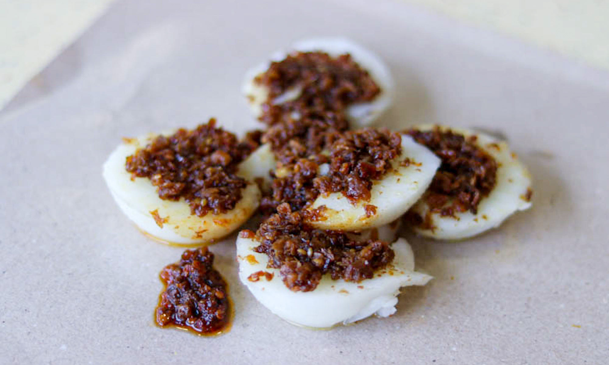 "Jian Bo Chwee Kueh from Tiong Bahru Market. Topped with radish ""chye poh"" and chilli."